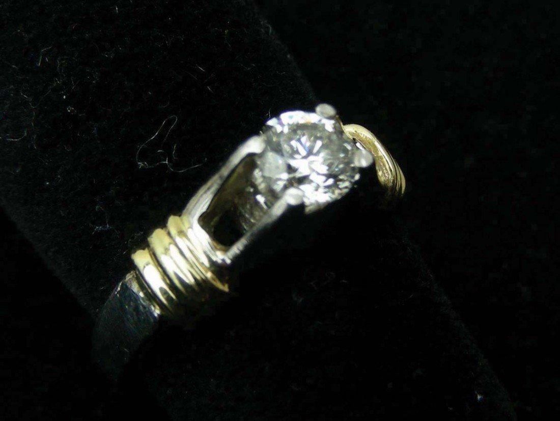 23: LADIES PLATINUM AND 18K YELLOW GOLD AND DIAMOND SOL