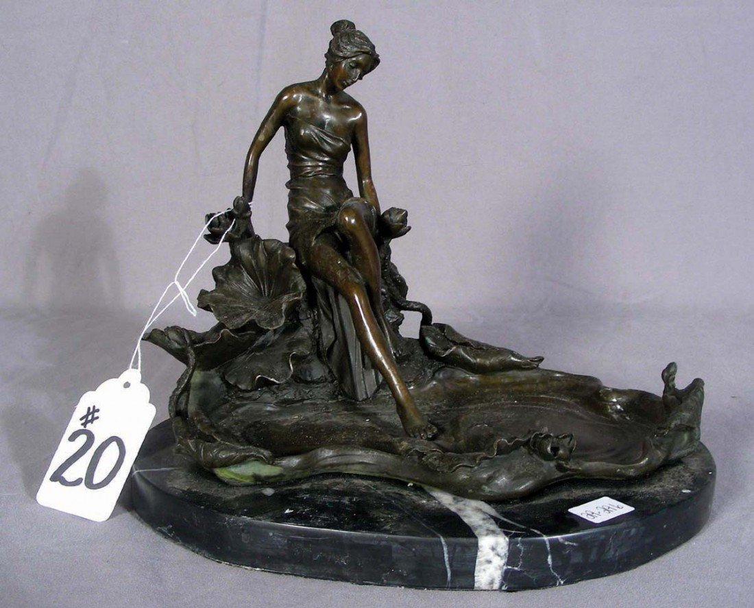 20: BRONZE SCULPTURE OF WOMAN SEATED BY A POND