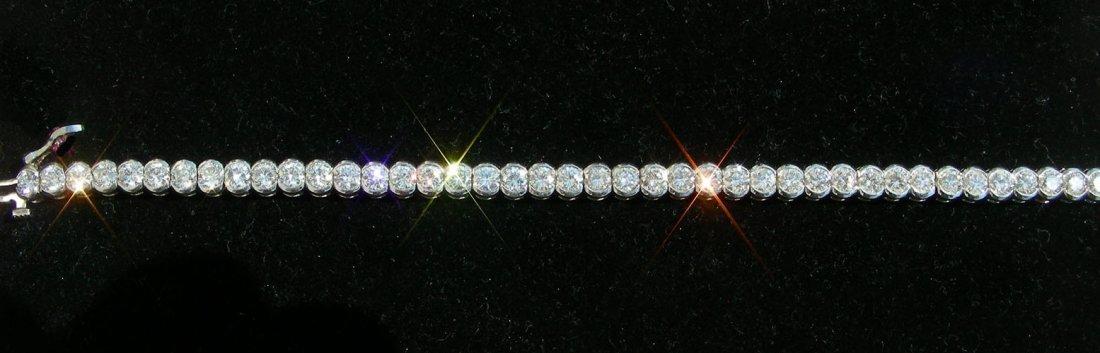 53: LADIES 14K WHITE GOLD AND DIAMOND ETERNITY BRACELET