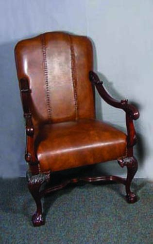 60: FINE HAND CRAVED MAHOGANY AND LEATHER ARMCHAIR