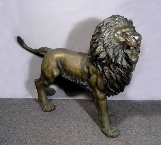 58: OUTSTANDING LIFE SIZE BRONZE SCULPTURE OF A LION