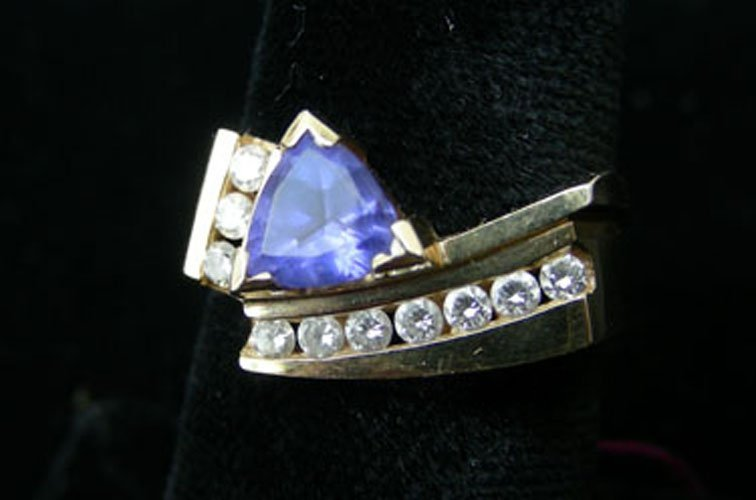 63: LADIES 14K YELLOW GOLD, TANZANITE AND DIAMOND RING