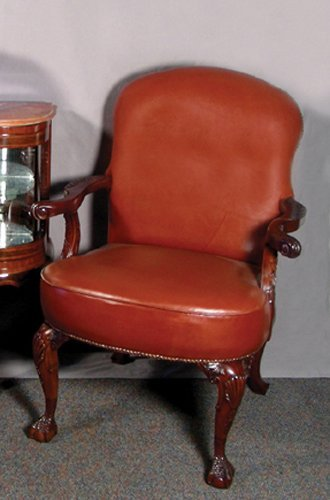 70: HAND CRAVED ENGLISH MAHOGANY AND LEATHER ARMCHAIR