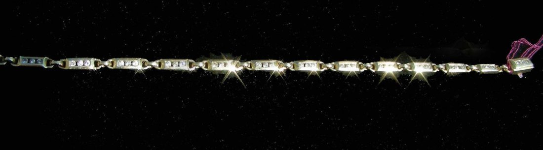 23: LADIES 14K YELLOW GOLD AND DIAMOND BRACELET