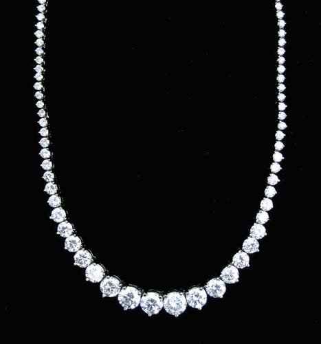 103: OUTSTANDING LADIES 14K WHITE GOLD AND DIAMOND ETER