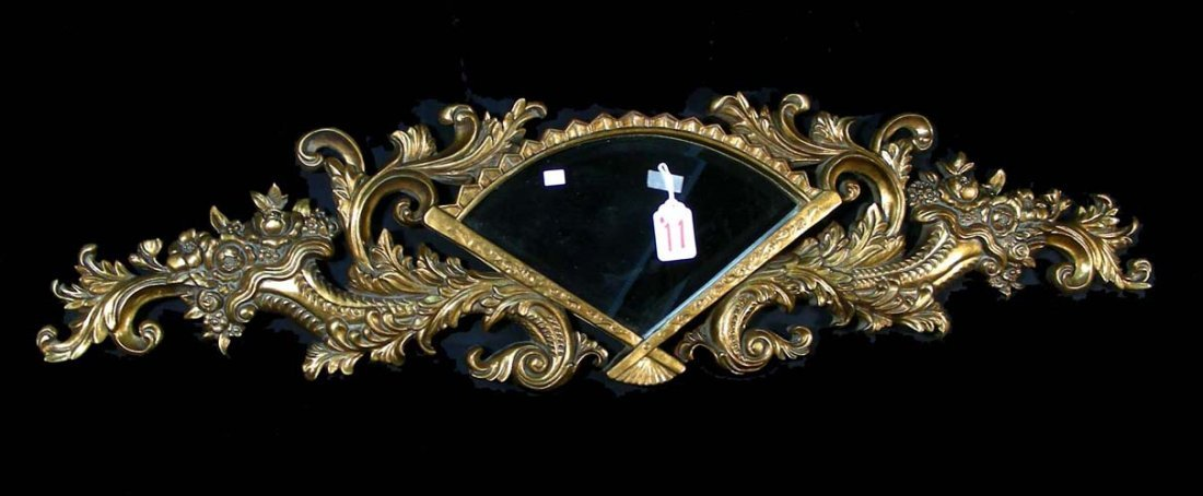 11: UNUSUALLY SHAPED GILT AND BEVELED GLASS MIRROR