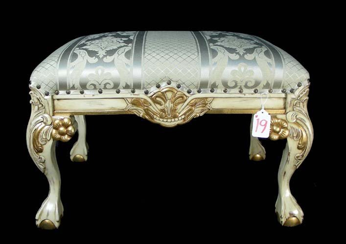 19: HAND CARVED WOODEN AND UPHOLSTERED BENCH