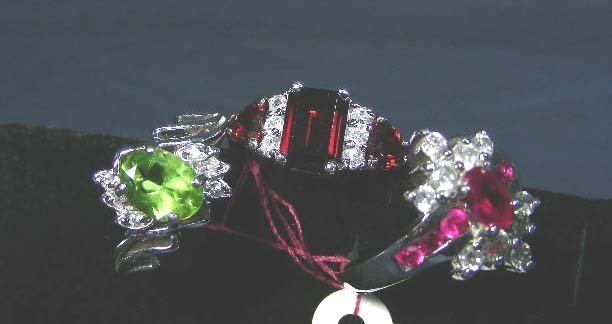 3: THREE STERLING SILVER RINGS WITH SYNTHETIC STONES