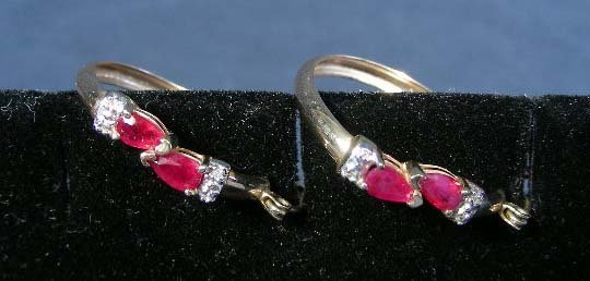 9: PAIR LADIES 10K YELLOW GOLD AND RUBY HOOP EARRINGS