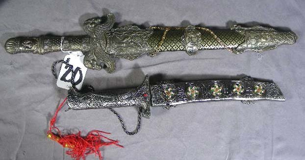 20: TWO DECORATIVE METAL ORIENTAL DAGGERS
