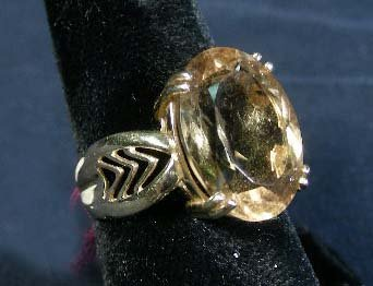 23: LADIES 14K YELLOW GOLD AND SMOKY TOPAZ RING