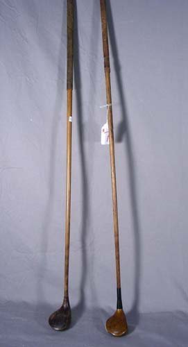 TWO ANTIQUE WOODEN GOLF CLUBS