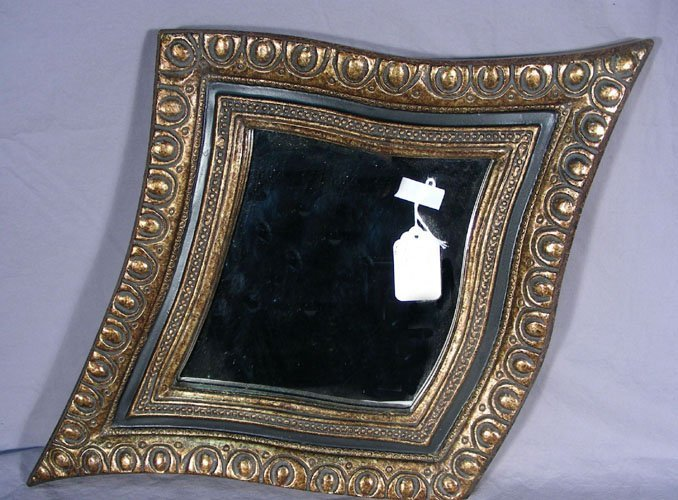 SALVADOR DALI STYLE MIRROR WITH BLACK AND GILT FRAME