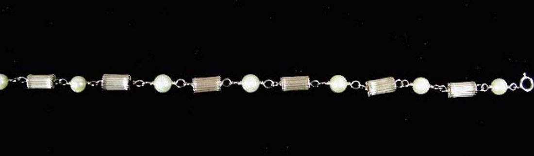14K YELLOW GOLD AND PEARL BRACELET