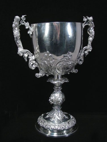 OUTSTANDING LARGE SILVER FIGURAL PRESENTATION CUP WITH