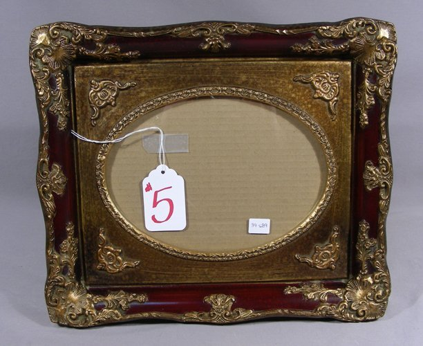 ROSEWOOD COLORED AND GILT PHOTO FRAME