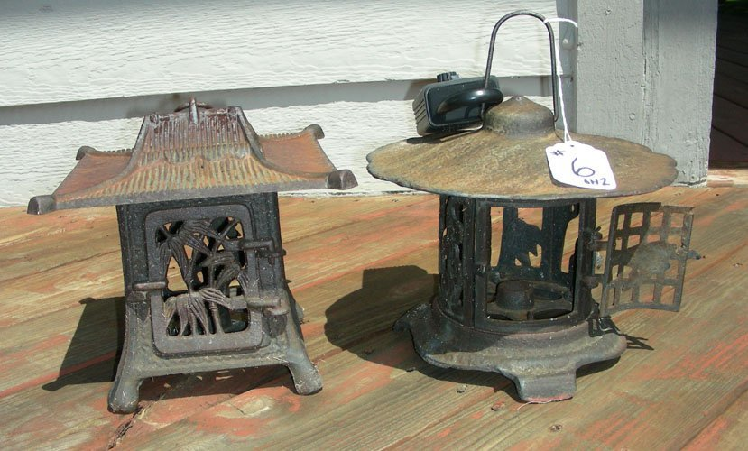 TWO HEAVY VINTAGE CAST IRON ORIENTAL MOTIF CANDLE