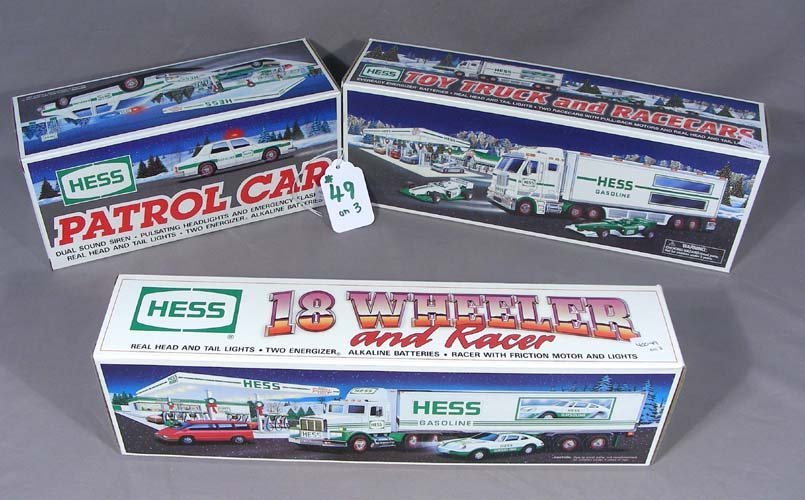 THREE VINTAGE HESS BATTERY OPERATED TOY TRUCKS