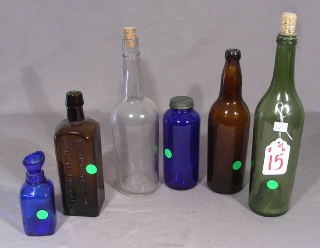 SEVEN VINTAGE GLASS BOTTLES