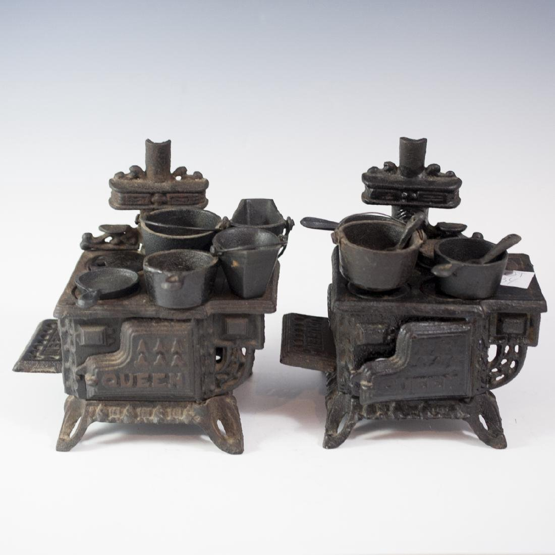 Pair of Queen Cast Iron Miniature Salesman Stoves