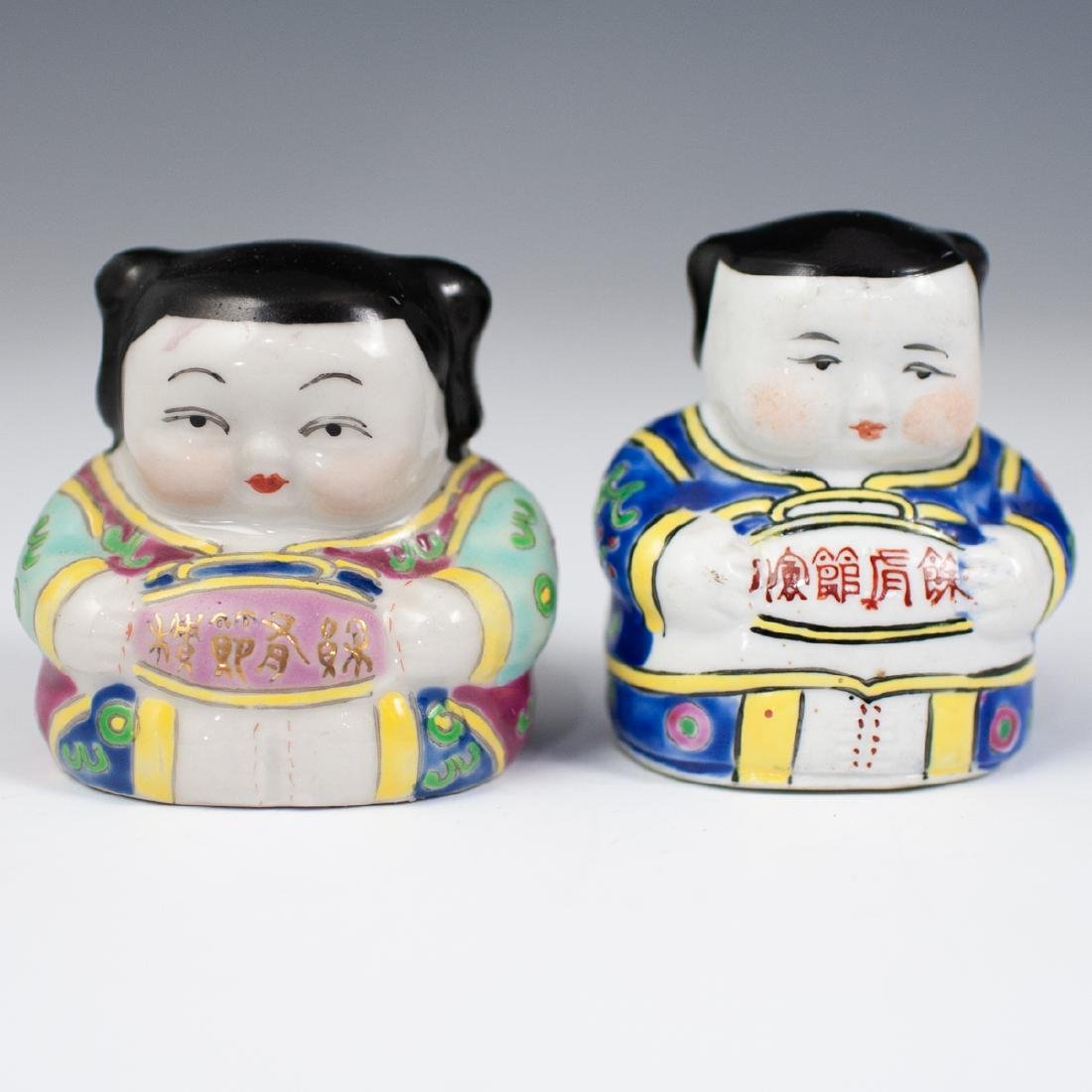 Pair Of Chinese Porcelain Buddhas