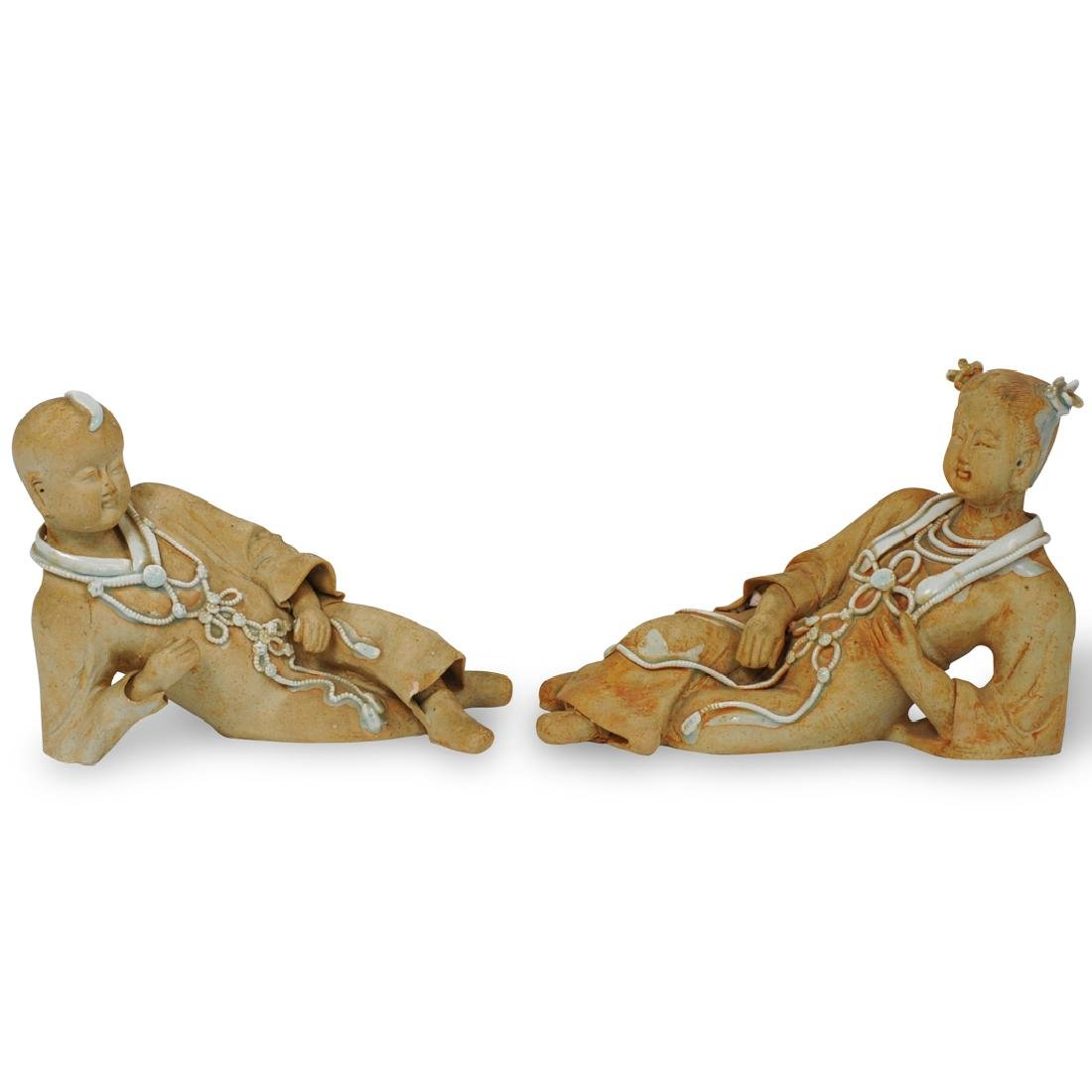 Pair of Chinese Reclining Figures