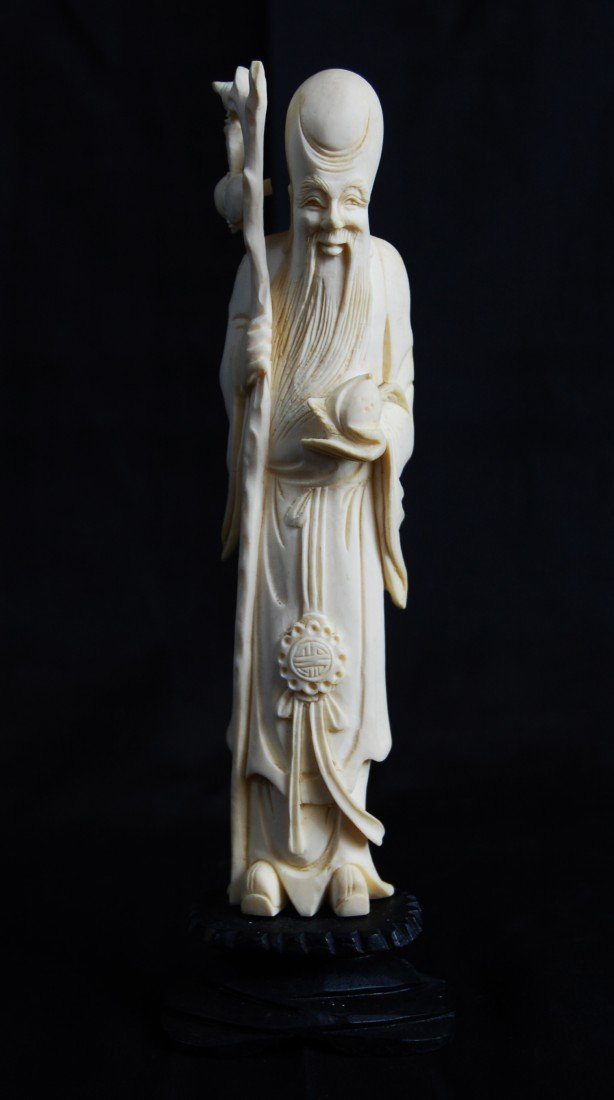 2: Chinese ivory figurine. Stamped at the bottom