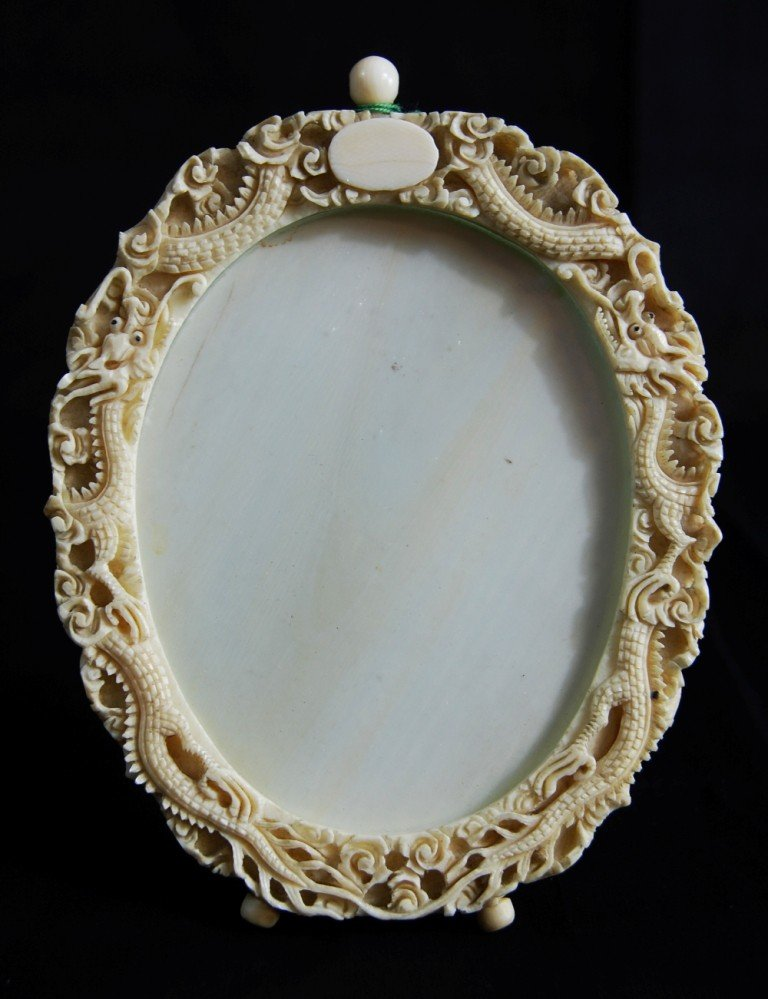 7: Chinese ivory frame with detailed dragon carving