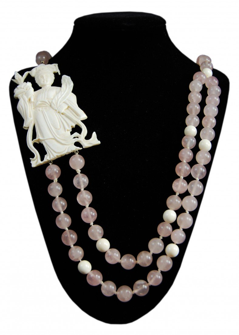 24: Chinese necklace with ivory figurine