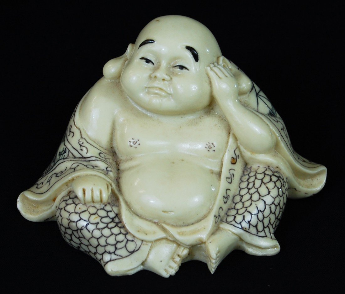 2: Smiling composite Buddha with erotic on bottom