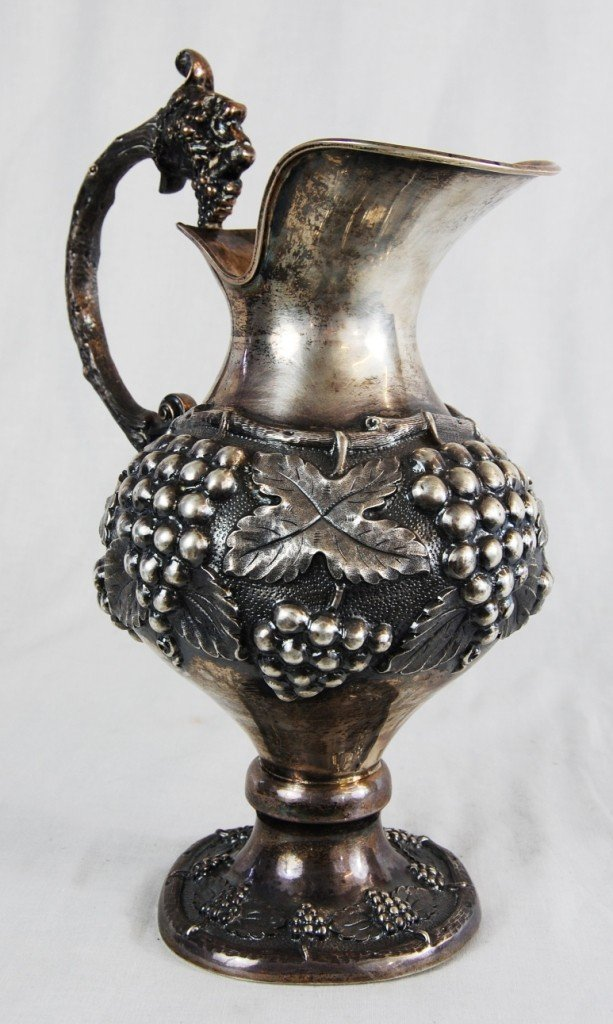 5: Hand made sterling silver wine pitcher. Marked