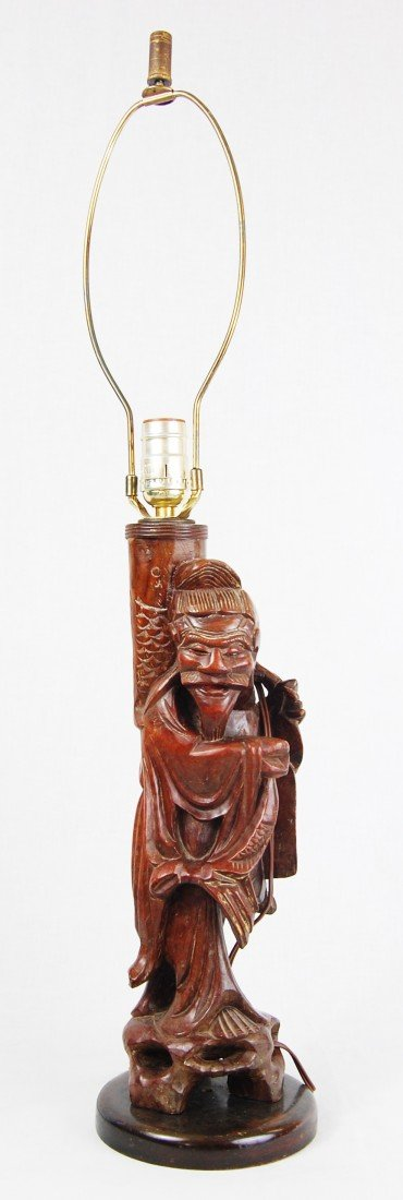 18: Chinese hand carved wood figural lamp