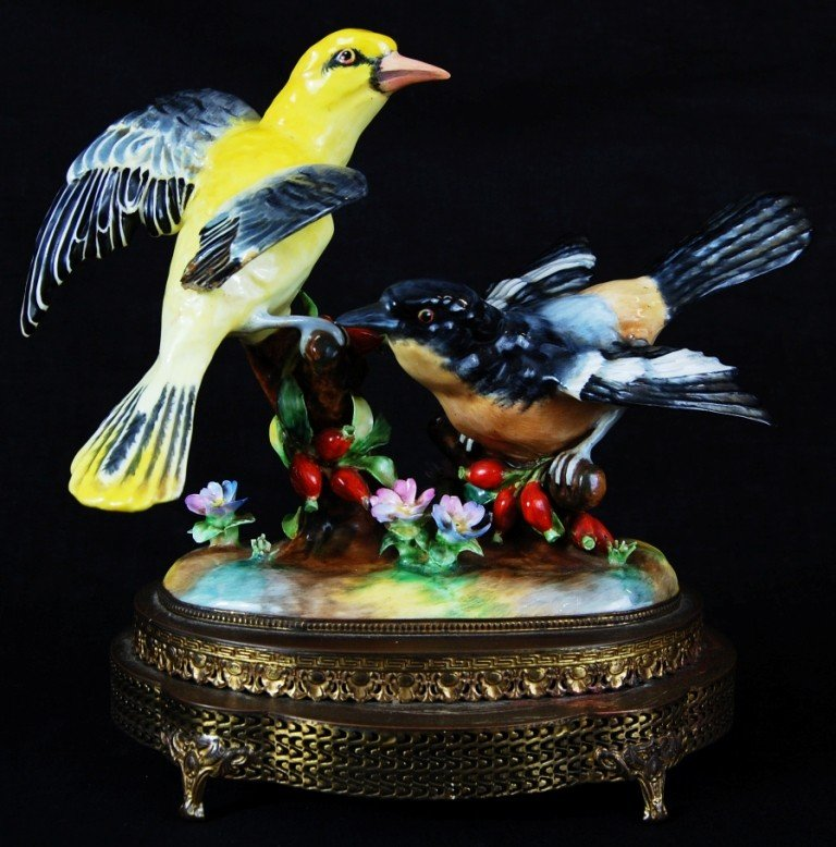 11: Antique porcelain birds on a metal base. German