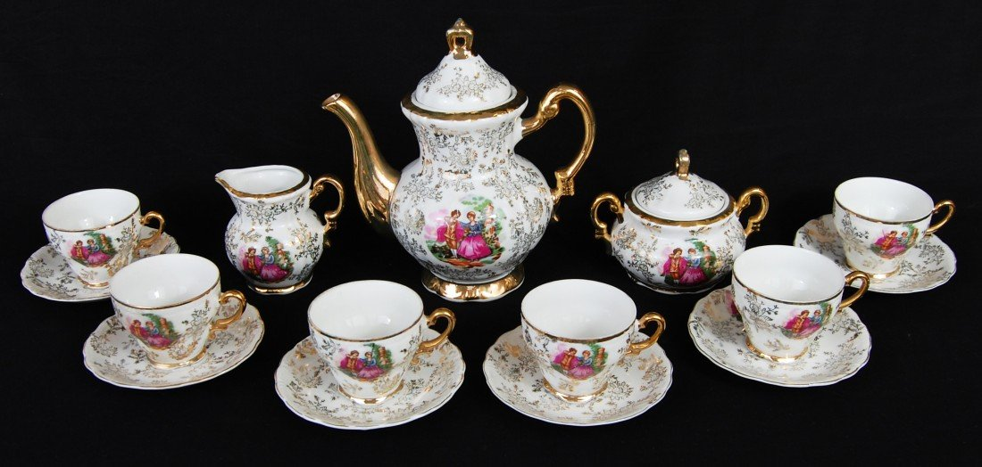 13: Limoges style hand painted tea set with gold overla