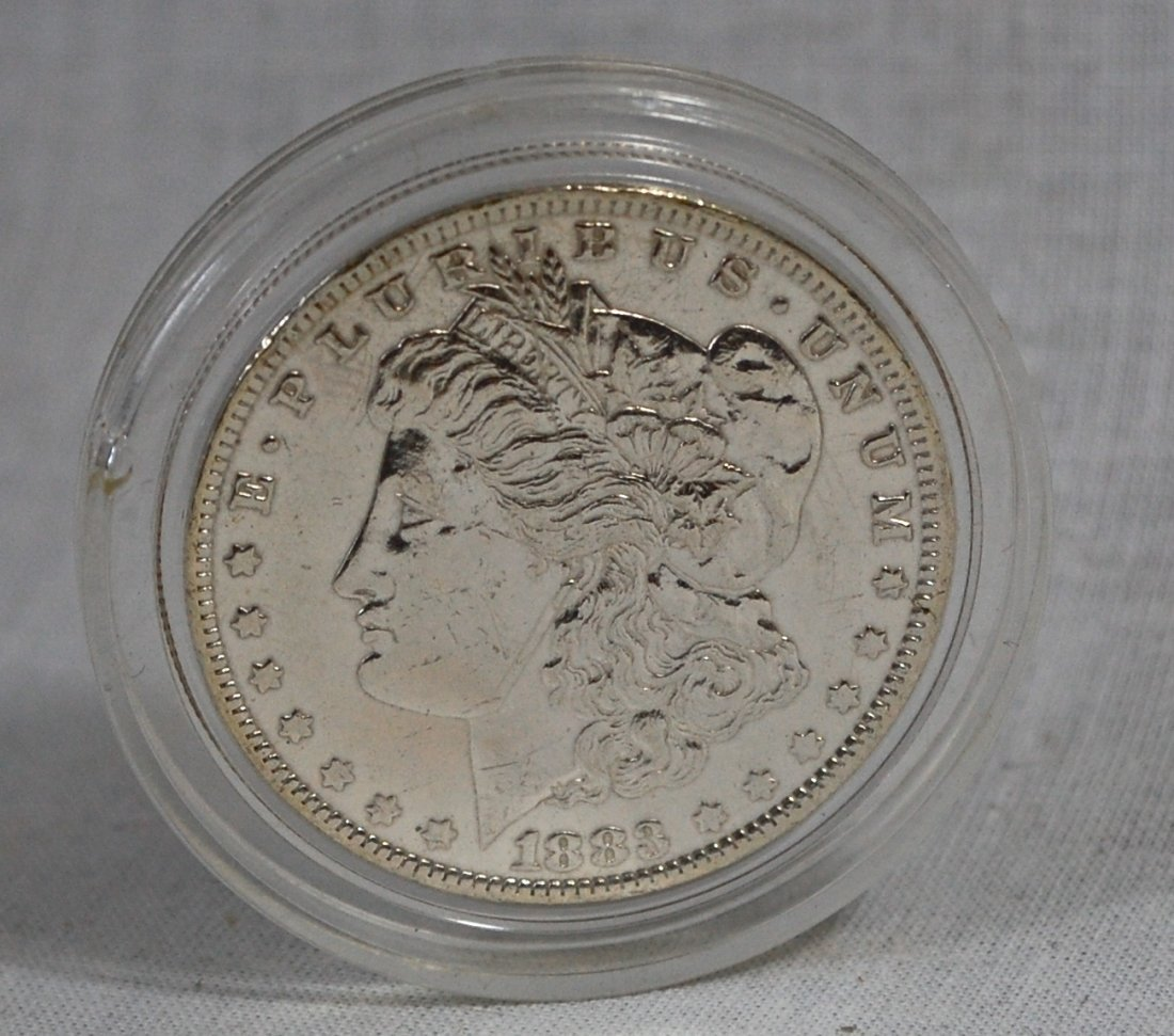 2: 1883 US dollar silver coin in plastic container