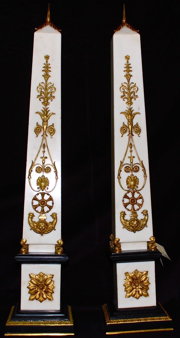 21: Pair of antique marble gilded bronze oblisques