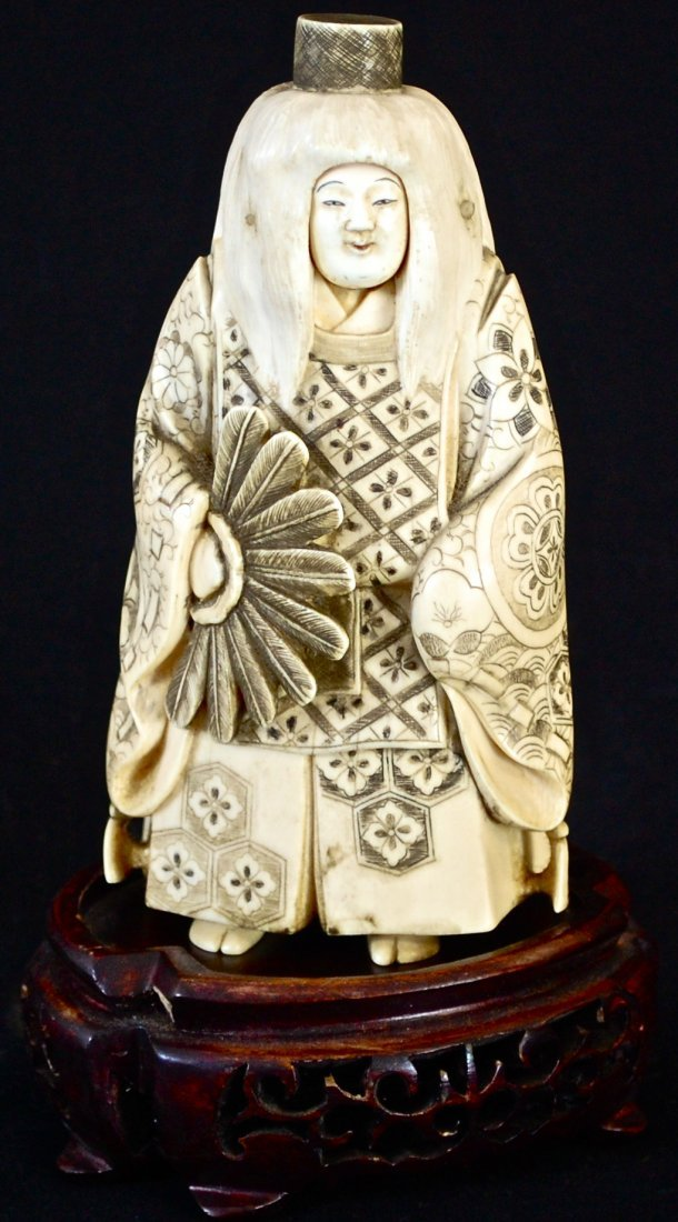 24: Japanese ivory figurine with changing faces. Signed