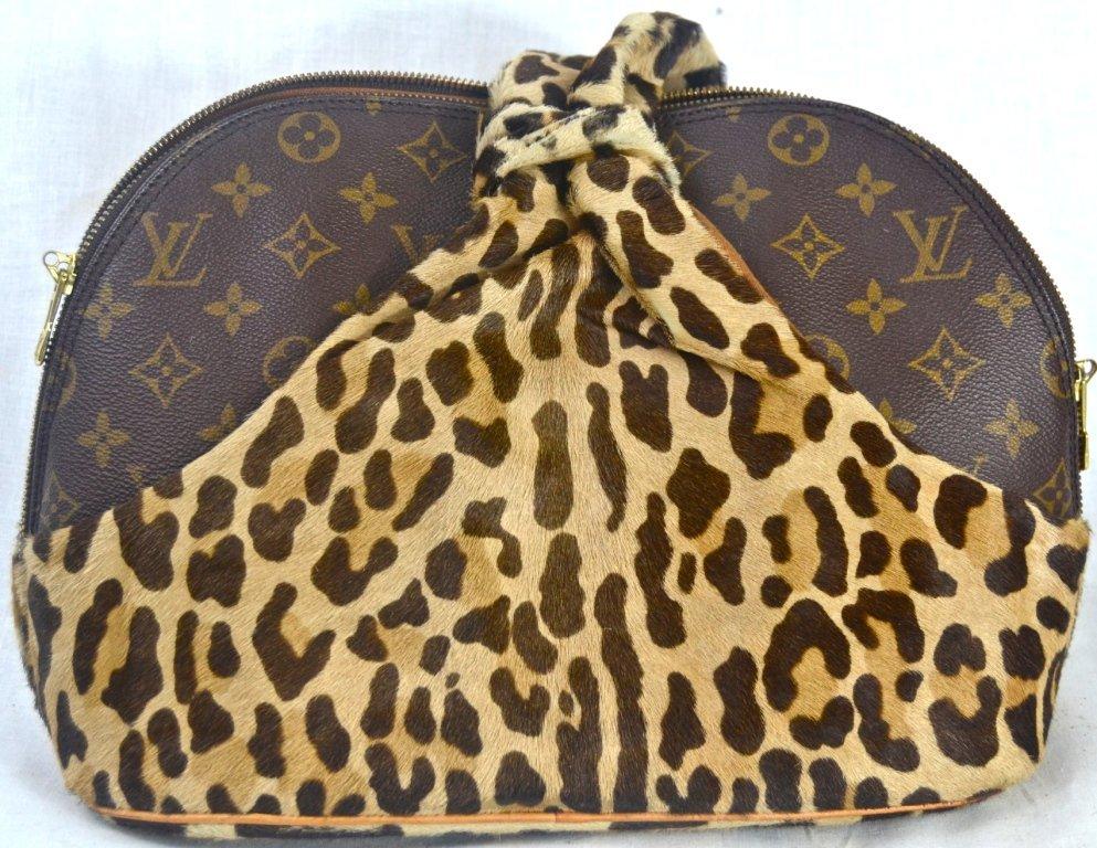 248: Louis vuitton ladies hand bag by Alaia