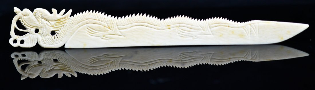 3: Antique Chinese carved ivory letter opener of a drag