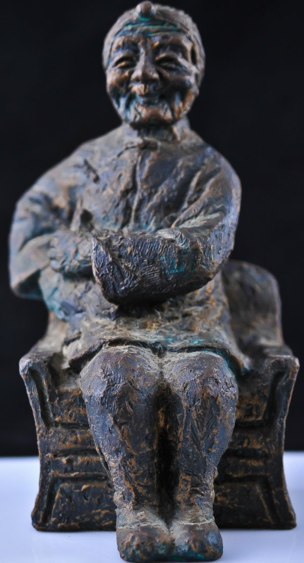14: Antique Chinese ceramic man sitting in chair. Signe