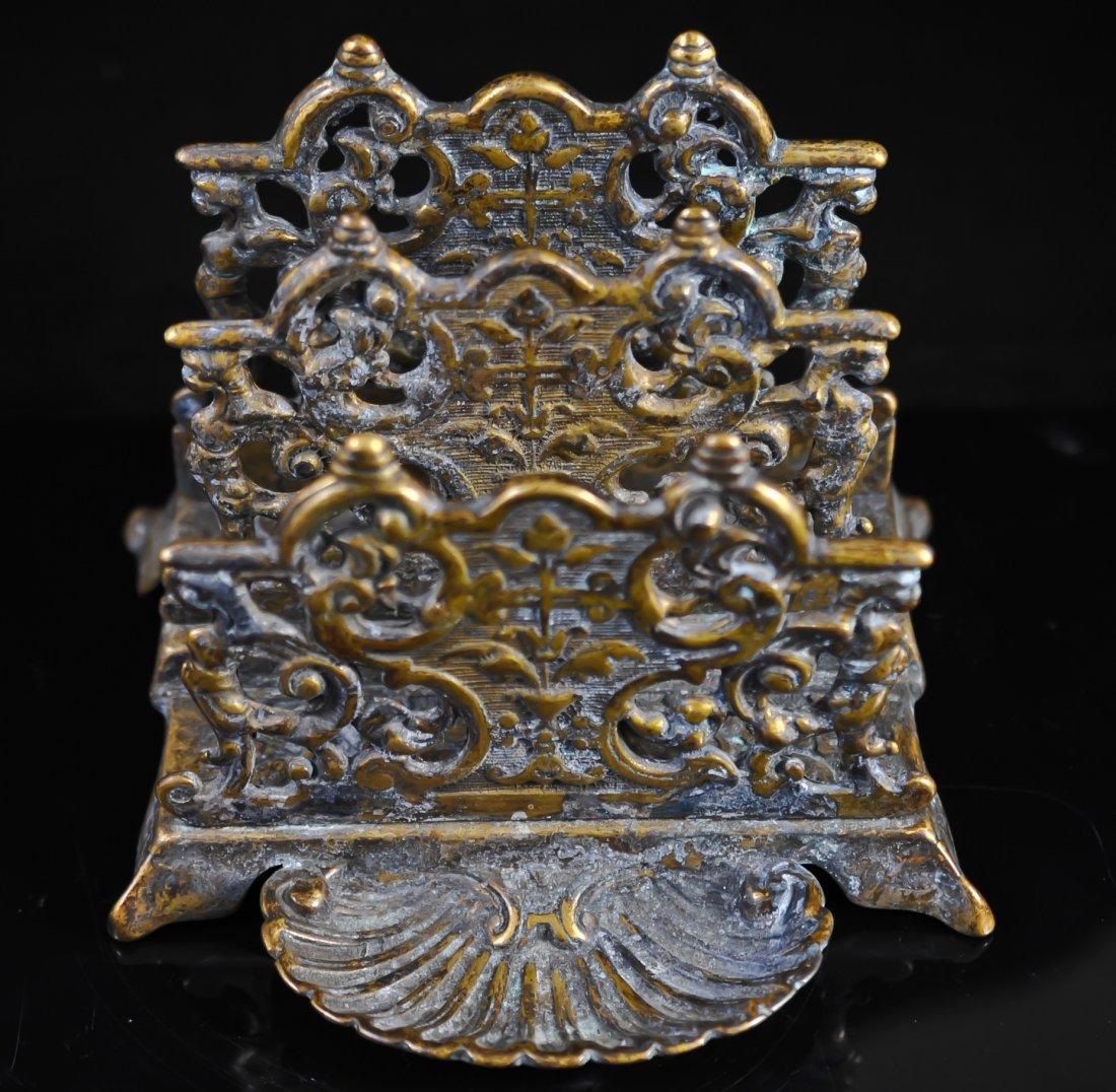 18: Bronze ornate desktop letter and book holder