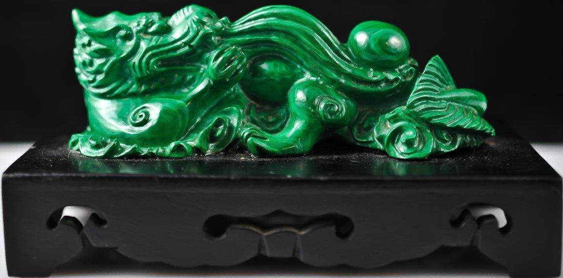 19: Chinese malachite dragon figure on a black wood bas