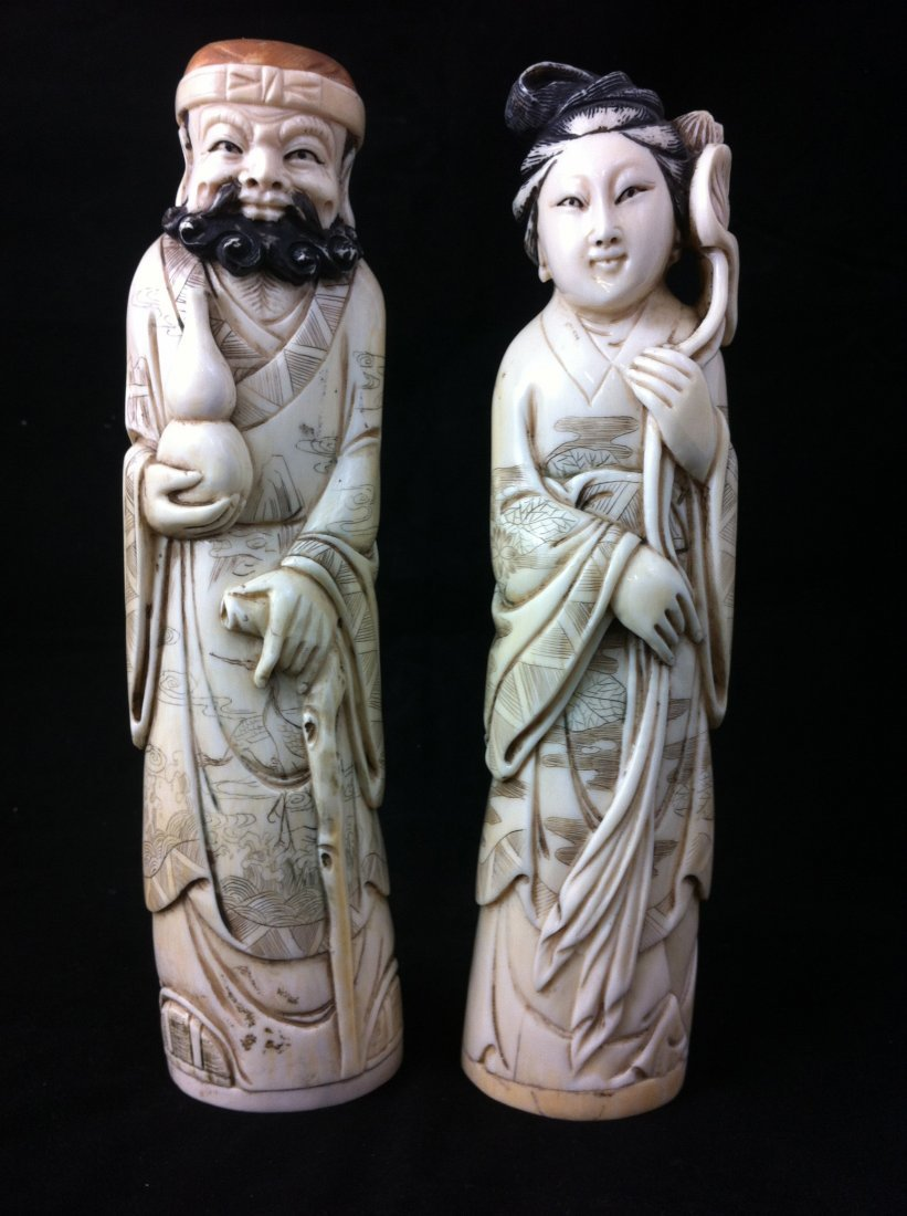 4: Pair of Chinese carved ivory king and queen. signed