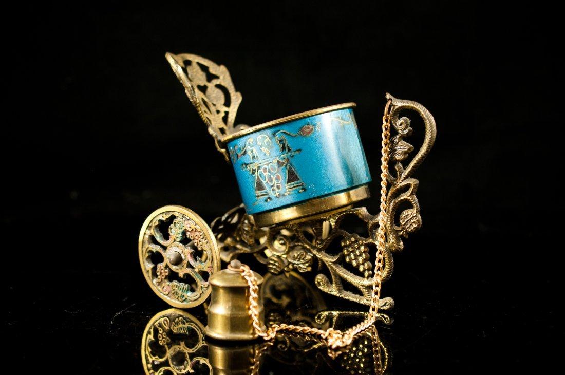 20: Judaic brass and enamel wine bottle holder