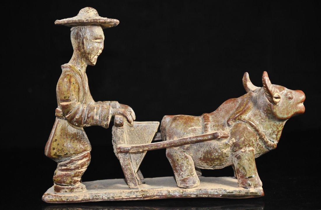 23: Primitive Chinese ceramic figure of a farmer