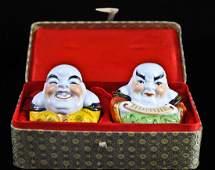 98: Pair of porcelain Buddha figurines in original box
