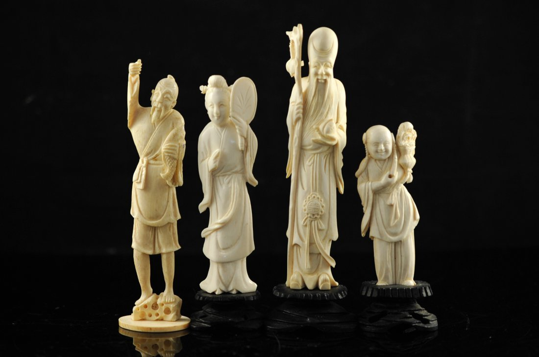 7: Lot of four Chinese carved ivory figures on original