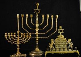 22: Lot of three vintage brass menorahs