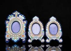 55 Set of three silver and enamel picture frames