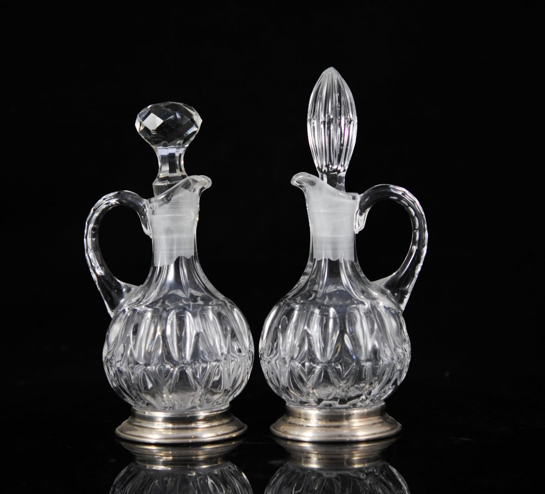 Pair of European crystal and sterling pitchers